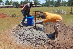 The Water Project: Kapkeruge Primary School -  Mixing Concrete