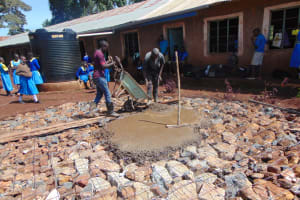 The Water Project: Kapkeruge Primary School -  Pouring Concrete Foundation