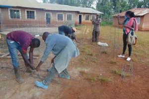 The Water Project: Kapkeruge Primary School -  Preparing Wire Pillar Reinforcements