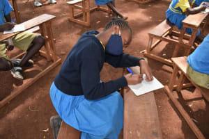 The Water Project: Kapkeruge Primary School -  A Student Takes Notes At Training