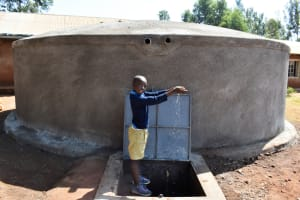 The Water Project: Kapkeruge Primary School -  Adrian Celebrating Water At The Tank