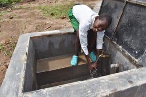 The Water Project: Mwembe Primary School -  Enjoying Water