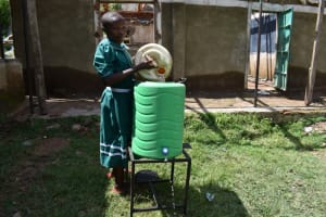 The Water Project: Mwembe Primary School -  Filling Handwashing Station