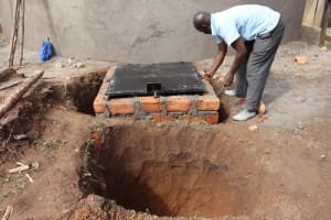 The Water Project: Mwembe Primary School -  Manhole Cover Placing