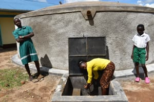 The Water Project: Mwembe Primary School -  Posing At The Tank