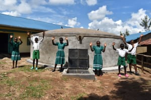 The Water Project: Mwembe Primary School -  Pupils At Water Tank