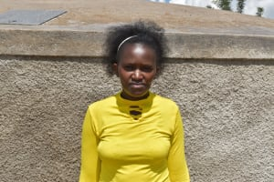 The Water Project: Mwembe Primary School -  Teacher At The Tank