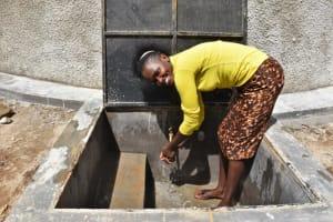 The Water Project: Mwembe Primary School -  Teacher Enjoying Water