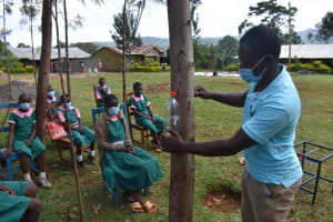 The Water Project: Itieng'ere Primary School -  Demonstrating Leaky Tin
