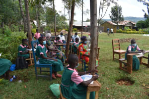The Water Project: Itieng'ere Primary School -  Participants Taking Notes
