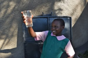 The Water Project: Itieng'ere Primary School -  Child Enjoying The Water