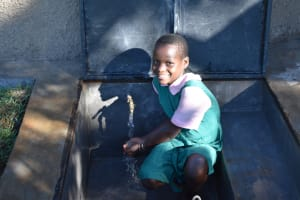 The Water Project: Itieng'ere Primary School -  Child Washing Hands
