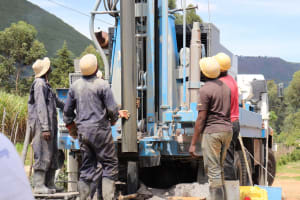 The Water Project: Muriola Primary School -  Removing The Metal Casing