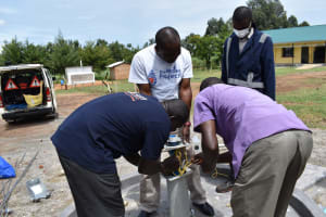 The Water Project: Muriola Primary School -  Installing Safety Rope