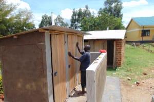 The Water Project: Muriola Primary School -  Latrine Door Fixing