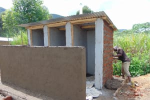 The Water Project: Muriola Primary School -  Latrine Plastering