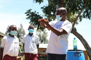 The Water Project: Muriola Primary School -  Demonstrating Handwashing