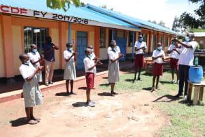 The Water Project: Muriola Primary School -  Demonstrating Handwashing Steps