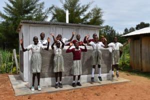 The Water Project: Muriola Primary School -  Girls Celebrating Their Latrine