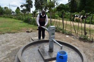 The Water Project: Muriola Primary School -  Headteacher Evans M Enjoys Water