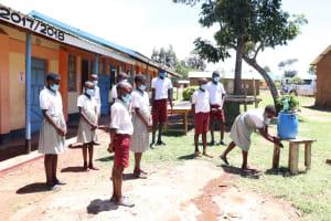 The Water Project: Muriola Primary School -  Practice Handwashing Steps
