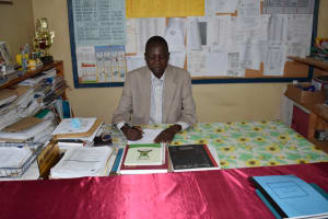 The Water Project: Shamberere Boys' High School -  Principal At His Desk