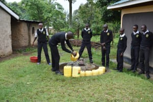 The Water Project: Shamberere Boys' High School -  Students Fetching Water
