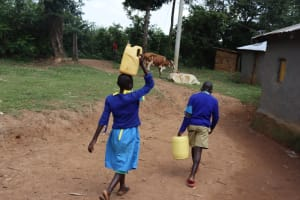 The Water Project: Bukhakunga Primary School -  Carrying Water From Home To School