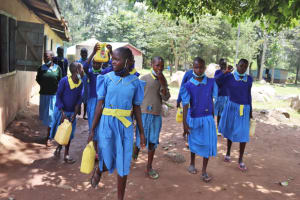 The Water Project: Bukhakunga Primary School -  Girls Carrying Water To School