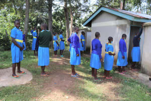 The Water Project: Bukhakunga Primary School -  Girls Lining Up To Use The Latrine
