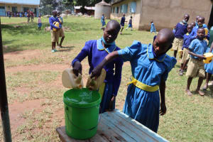The Water Project: Bukhakunga Primary School -  Pupils Filling Handwashing Stations With Water