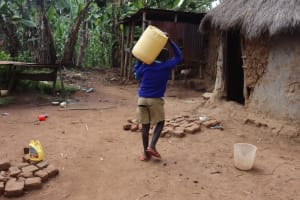 The Water Project: Bukhakunga Primary School -  Repatry Carrying Water Home From The Spring