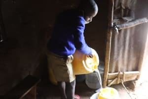 The Water Project: Bukhakunga Primary School -  Repatry Pouring Water Into A Container At Home