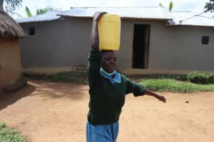 The Water Project: Bukhakunga Primary School -  Seline Wanjala Carrying Water To School From Home