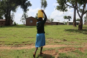 The Water Project: Bukhakunga Primary School -  Seline Carrying Water Back Home From The Spring