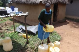 The Water Project: Bukhakunga Primary School -  Seline Wanjala Transfering Water To A Different Container