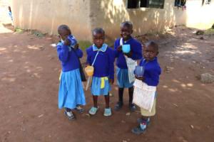 The Water Project: Bukhakunga Primary School -  Young Pupils Eating Porridge