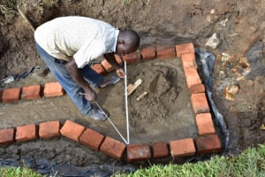 The Water Project: Ematetie Community, Amasetse Spring -  Starting The Walls
