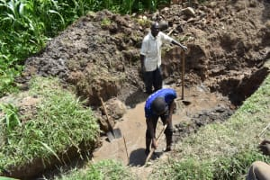 The Water Project: Ematetie Community, Amasetse Spring -  Clearing Of Drainage Channel