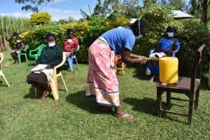 The Water Project: Ematetie Community, Amasetse Spring -  Handwashing Session