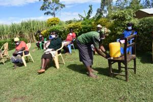 The Water Project: Ematetie Community, Amasetse Spring -  Handwashing