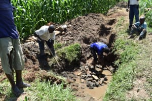 The Water Project: Ematetie Community, Amasetse Spring -  Layer Of Large Rocks