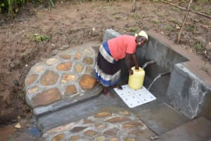 The Water Project: Ematetie Community, Amasetse Spring -  Martha A Collecting Water