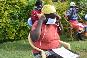 The Water Project: Ematetie Community, Amasetse Spring -  Particicpants Putting On Masks