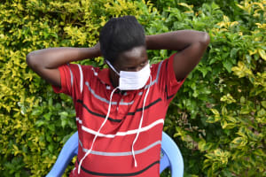 The Water Project: Ematetie Community, Amasetse Spring -  Participant Putting On Mask