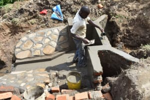The Water Project: Ematetie Community, Amasetse Spring -  Plastering Headwall