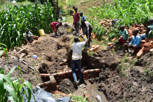 The Water Project: Ematetie Community, Amasetse Spring -  Plenty Of Help