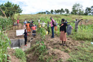 The Water Project: Ematetie Community, Amasetse Spring -  Practicing Physical Distance