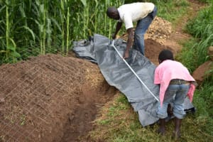 The Water Project: Ematetie Community, Amasetse Spring -  Preparing The Plastic