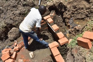 The Water Project: Ematetie Community, Amasetse Spring -  Progress On Head And Wing Walls